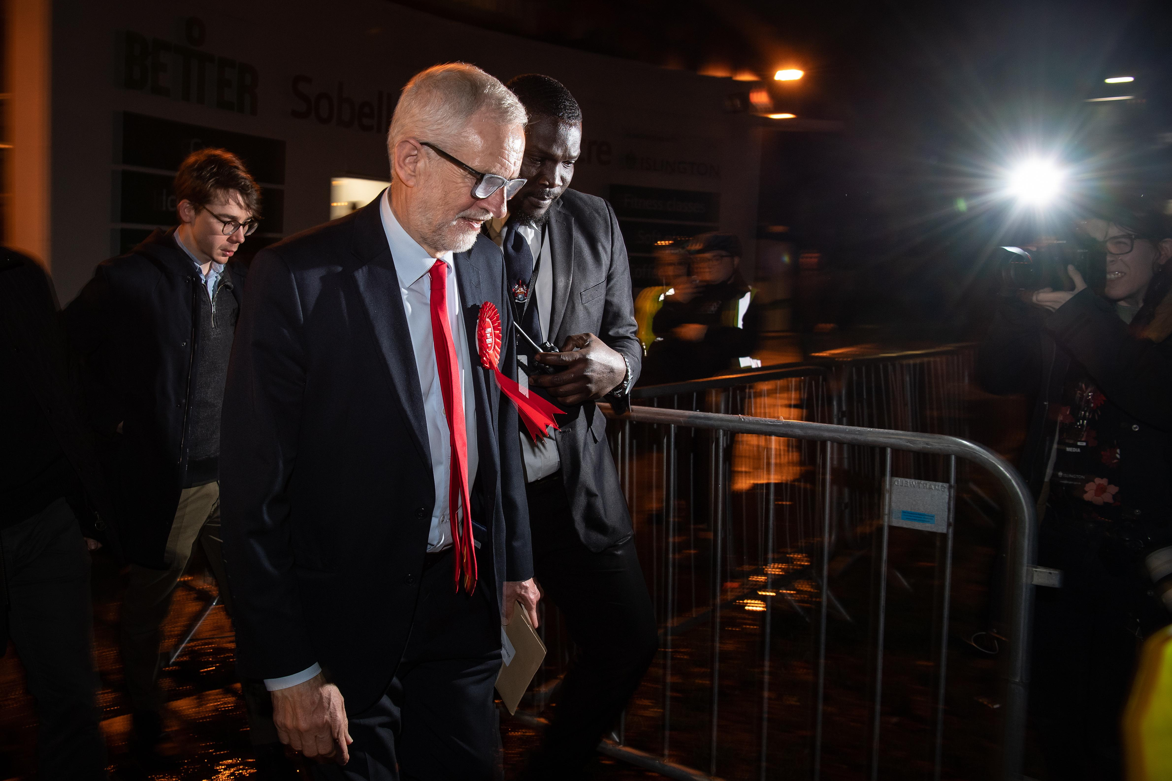 LONDON, ENGLAND - DECEMBER 13: Jeremy Corbyn, leader of the Labour Party, leaves the vote count in his Islington North constituency on December 13, 2019 in London, England. Corbyn, who has held the Islington North seat since 1983, retained his seat but is expected to step down as leader following his party's decisive defeat by the Conservatives and Prime Minister Boris Johnson. The Prime Minister called the first UK winter election for nearly a century in an attempt to gain a working majority to break the parliamentary deadlock over Brexit. The election results from across the country are being counted overnight and an overall result is expected in the early hours of Friday morning. (Photo by Leon Neal/Getty Images)
