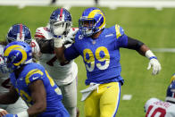 Los Angeles Rams defensive end Aaron Donald, right, works against the New York Giants during the first half of an NFL football game Sunday, Oct. 4, 2020, in Inglewood, Calif. (AP Photo/Ashley Landis)
