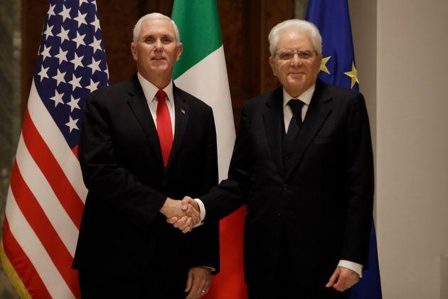 Vice President Mike Pence shakes hands with the President of the Italian Republic Sergio Mattarella, right, during their meeting at the Quirinale Presidential palace, in Rome, Friday, Jan 24, 2020. (AP Photo/Alessandra Tarantino)