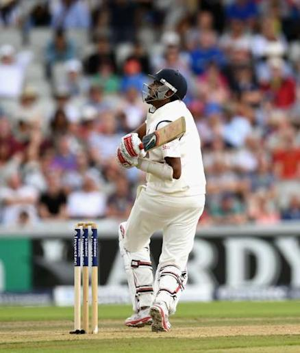 MANCHESTER, ENGLAND - AUGUST 07: India batsman Ravichandran Ashwin hits James Anderson for six runs during day one of the 4th Investec Test match between England and India at Old Trafford on August 7, 2014 in Manchester, England. (Photo by Stu Forster/Getty Images)