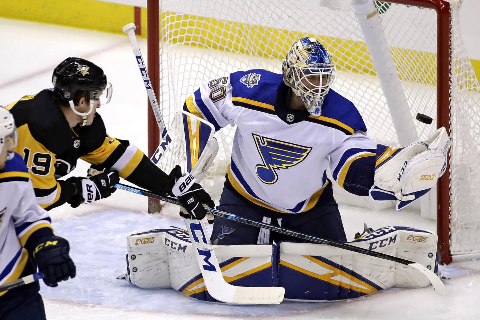 Pittsburgh Penguins' Jared McCann (19) can't redirect a shot past St. Louis Blues goaltender Jordan Binnington (50) during the first period of an NHL hockey game in Pittsburgh, Wednesday, Dec. 4, 2019. (AP Photo/Gene J. Puskar)