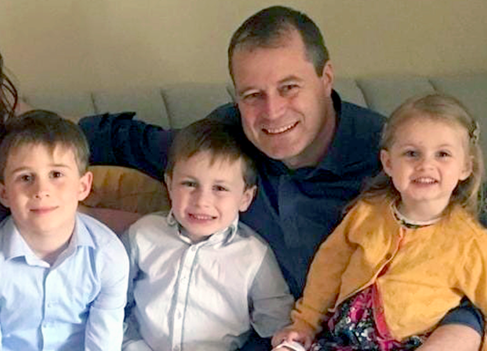 Andrew McGinley with his three children, nine-year-old Conor, seven-year-old Darragh and three-year-old Carl (PA)