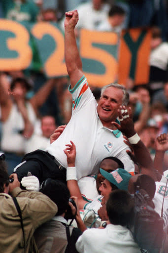 FILE - In this Nov. 14, 1993, file photo, Miami Dolphins coach Don Shula is carried on his team's shoulders after his 325th victory, at Philadelphia's Veterans Stadium. Shula, who won the most games of any NFL coach and led the Miami Dolphins to the only perfect season in league history, died Monday, May 4, 2020, at his home in Indian Creek, Fla., the team said. He was 90. (AP Photo/Amy Sancetta, File)