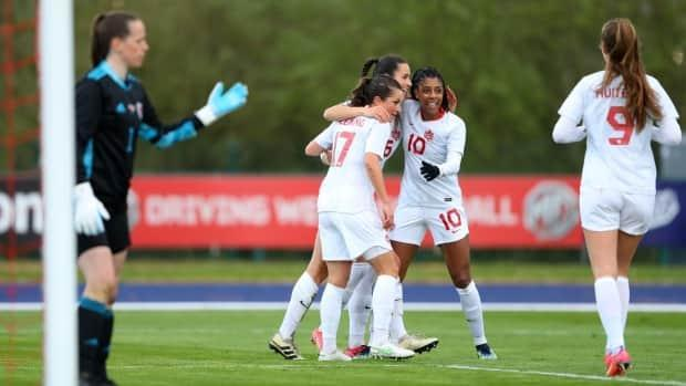 Evelyn Viens of Canada is shown celebrating with teammates Ashley Lawrence and Jessie Fleming in this file photo from April 9, 2021. The Canadian women's national soccer team learned on Wednesday that they are grouped with Japan, Britain, and Chile for the Tokyo 2020 Olympic tournament.