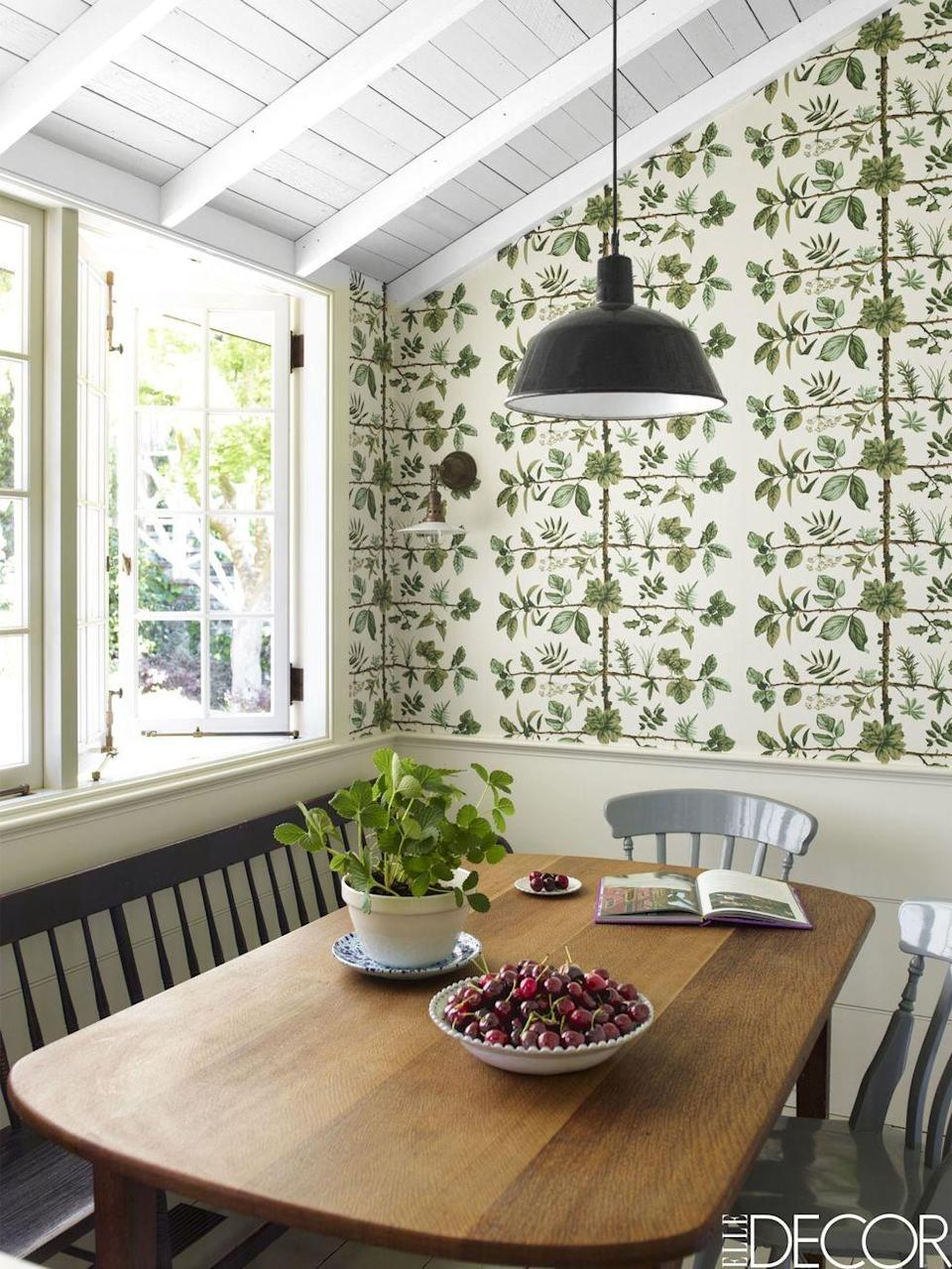 """<p>In typical California fashion, this <a href=""""https://www.elledecor.com/design-decorate/house-interiors/a8326/northern-california-home/"""" rel=""""nofollow noopener"""" target=""""_blank"""" data-ylk=""""slk:Mill Valley home"""" class=""""link rapid-noclick-resp"""">Mill Valley home</a> is nature-inspired from the color palette to the decor. The kitchen features a gorgeous leafy wallpaper design by Pierre Frey, accented by some real greenery on the dining table.</p><p><em>Mais-Green Leaf on White-Corn Printed Wallpaper, $300</em><br><a class=""""link rapid-noclick-resp"""" href=""""https://go.redirectingat.com?id=74968X1596630&url=https%3A%2F%2Fwww.1stdibs.com%2Ffurniture%2Fwall-decorations%2Fwallpaper%2Fmais-green-leaf-on-white-corn-printed-wallpaper%2Fid-f_12025883%2F%3Fgclid%3DCjwKCAjw8NfrBRA7EiwAfiVJpSEik8oszFeC_875EIR90nwDUzglKhcAoxMMwnEEkl4WCHSDswktKhoCHDAQAvD_BwE%26gclsrc%3Daw.ds&sref=https%3A%2F%2Fwww.redbookmag.com%2Fhome%2Fg35083191%2Fwallpaper-design-ideas%2F"""" rel=""""nofollow noopener"""" target=""""_blank"""" data-ylk=""""slk:Shop the Look"""">Shop the Look</a></p>"""