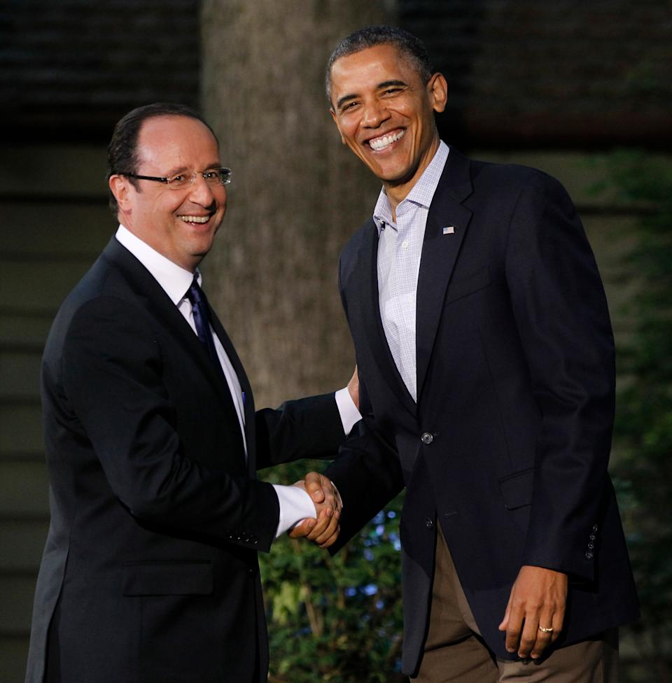 President Barack Obama shakes hands with French President Francois Hollande on arrival for the G8 Summit Friday, May 18, 2012 at Camp David, Maryland.