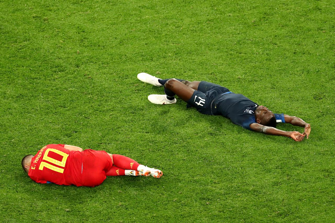 <p>Eden Hazard of Belgium and Blaise Matuidi of France lie on the pitch injured during the 2018 FIFA World Cup Russia Semi Final match between Belgium and France at Saint Petersburg Stadium on July 10, 2018 in Saint Petersburg, Russia. (Photo by Robert Cianflone – FIFA/FIFA via Getty Images) </p>