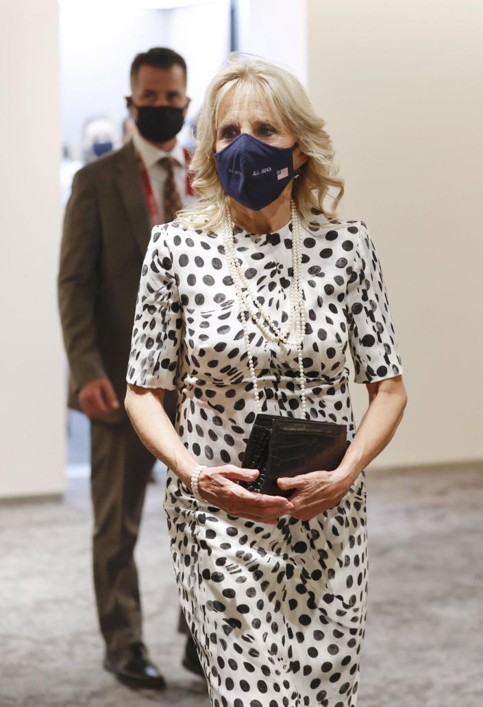 U.S. first lady Jill Biden arrives at the National Stadium in Tokyo on July 23, 2021, to attend the Tokyo Olympics opening ceremony. (Kyodo via AP Images). - Credit: Kyodo via AP Images.