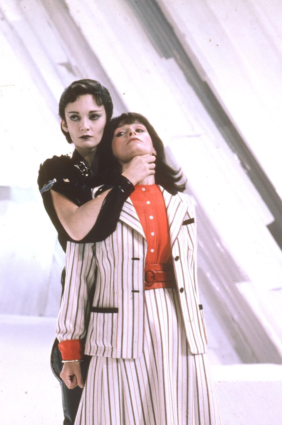 Ursa (Sarah Douglas) holds Lois Lane (Margot Kidder) captive in Superman II (Warner Bros.)