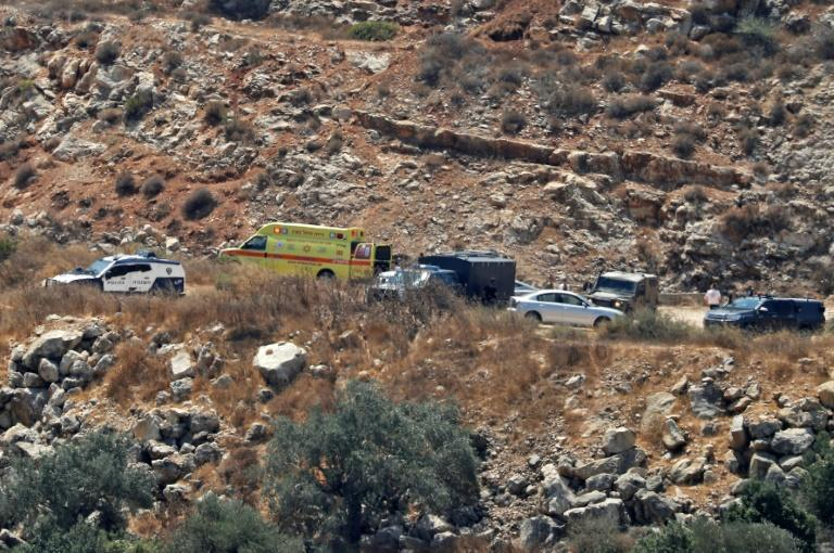 Israeli ambulance crews and security forces deploy to the scene of a bomb attack near the Israeli settlement of Dolev in the occupied West Bank on August 23, 2019