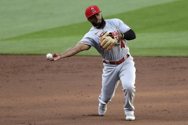 Angels second baseman Luis Rengifo throws to first base against the Seattle Mariners on Aug. 5.