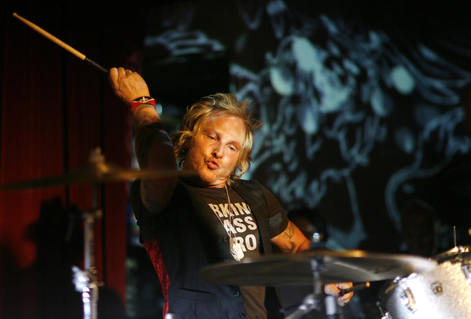 Drummer Matt Sorum performs with the Darling Stilettos at the 44th birthday party of former Guns N' Roses guitarist Slash in Hollywood, July 30, 2009. (REUTERS/Mario Anzuoni)