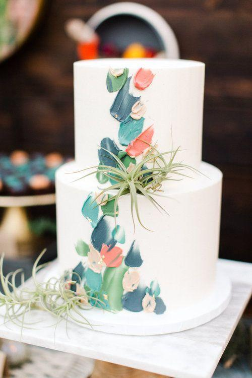 <p>Frosted brushstrokes turn this otherwise simple confection by Paper Cake Events into a work of art.</p>