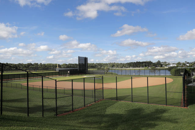 An empty practice field is seen at the Washington Nationals spring training baseball facility, Monday, March 16, 2020, in West Palm Beach, Fla. On Sunday night, the Centers for Disease Control and Prevention recommended gatherings of 50 people or more be canceled or postponed across the country for the next eight weeks. Major League Baseball planned to update teams Monday on its health policy.(AP Photo/Julio Cortez)