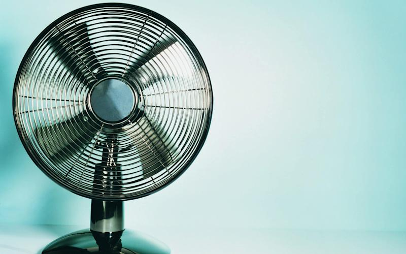 The unusual method of pointing a fan out of a window can help you keep cool in a heatwave - Digital Vision