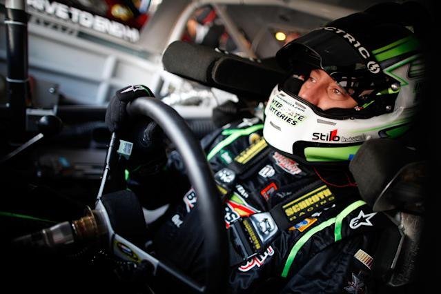 DOVER, DE - SEPTEMBER 30: Kyle Busch, driver of the #18 Interstate Batteries Toyota, prepares to drive during practice for the NASCAR Sprint Cup Series AAA 400 at Dover International Speedway on September 30, 2011 in Dover, Delaware. (Photo by Chris Graythen/Getty Images)