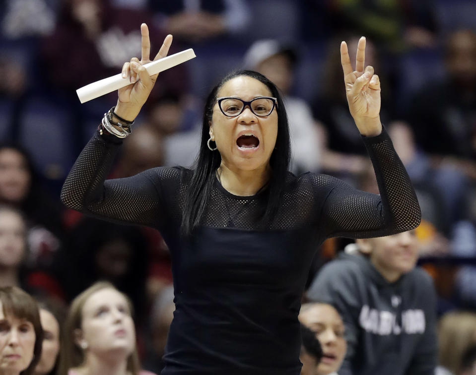 FILe - In this March 2, 2018, file photo, South Carolina head coach Dawn Staley yells to her players in the first half of an NCAA college basketball game against Tennessee at the women's Southeastern Conference tournament, in Nashville, Tenn. Buffalo coach Felisha Legette-Jack and Dawn Staley were two of only six black female head coaches in the NCAA Tournament this year. None are in the Final Four. Staley became the second black coach to win a national championship when she guided South Carolina to the title last year. She hopes that she can be an inspiration. (AP Photo/Mark Humphrey, File)