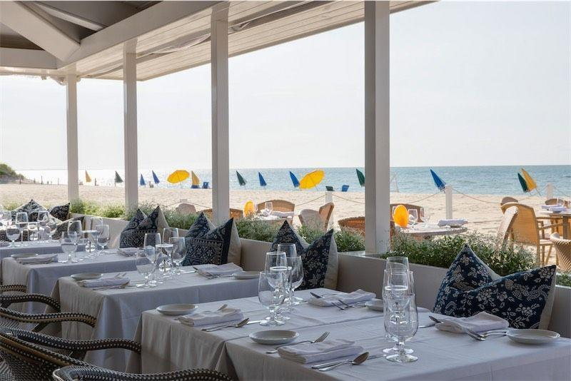 """<p><a href=""""https://galleybeach.net/"""" rel=""""nofollow noopener"""" target=""""_blank"""" data-ylk=""""slk:Galley Beach"""" class=""""link rapid-noclick-resp"""">Galley Beach</a> isn't just adored for its unparalleled oceanfront dining experience—this establishment offers some of the best food on the island, <a href=""""https://www.veranda.com/travel/weekend-guides/g32852304/what-to-do-in-nantucket/"""" rel=""""nofollow noopener"""" target=""""_blank"""" data-ylk=""""slk:according to Tuckernuck Co-Founder Jocelyn Gailliot"""" class=""""link rapid-noclick-resp"""">according to Tuckernuck Co-Founder Jocelyn Gailliot</a>. However, the sunset views and nearly 100-year-history of incredible hospitality don't hurt either.</p><p>Galley Beach is the place to see and be seen (former presidents and many a celebrity have dined here), but the award-winning cuisine is what keeps people coming back for more, from the tuna tartare tacos to delectable local lobster. And while you may be tempted to stick to the cocktail or spritz menu, be sure to try one of the wines from Galley Beach's 5,000-bottle cellar. </p>"""