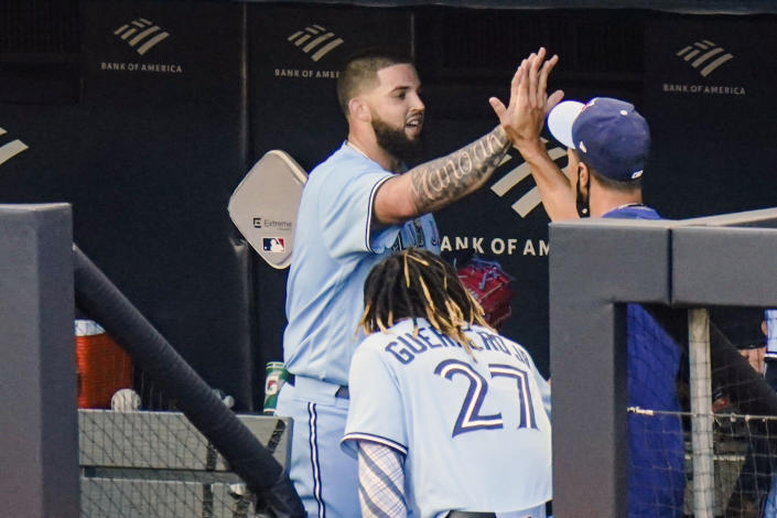Toronto Blue Jays' pitcher Alek Manoah celebrates with teammates after the sixth inning during the first game of a baseball doubleheader against the New York Yankees Thursday, May 27, 2021, in New York. (AP Photo/Frank Franklin II)