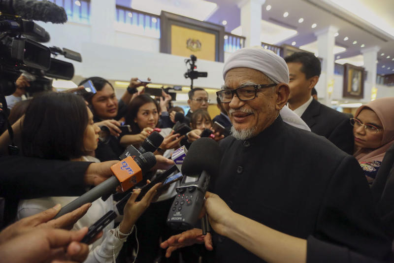 PAS president Datuk Seri Abdul Hadi Awang speaks to reporters in Parliament in Kuala Lumpur March 26, 2019. — Picture by Yusof Mat Isa