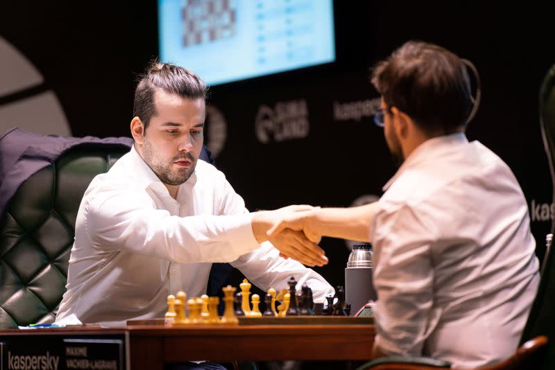 Grandmasters Ian Nepomniachtchi of Russia and Maxime Vachier-Lagrave of France play a chess game during the Candidates Tournament in Yekaterinburg