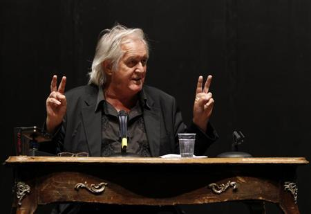 Swedish author Henning Mankell gestures during a news conference in Berlin