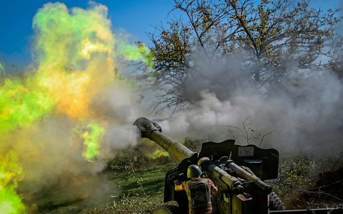 An Armenian soldier fires artillery on the front line on October 25, 2020, during the ongoing fighting between Armenian and Azerbaijan - Aris Messinis/AFP