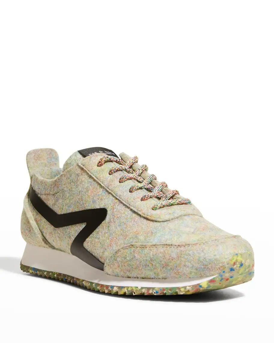 <p>You'll always stand out in these <span>Rag &amp; Bone Retro Recycled Runner Sneakers</span> ($250).</p>