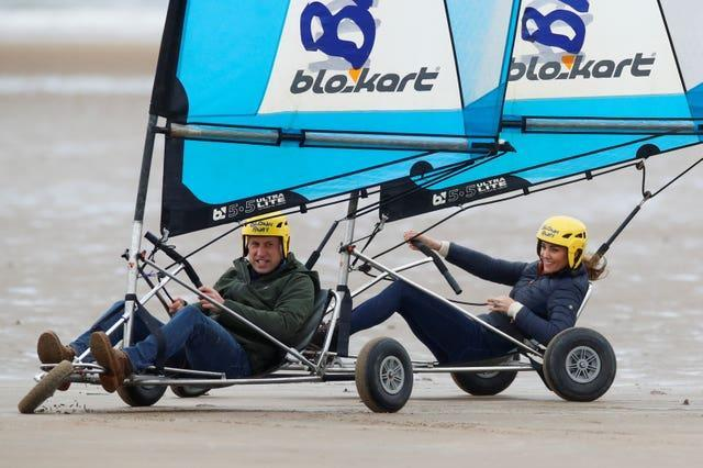 The Duke and Duchess of Cambridge land yachting on the beach at St Andrews