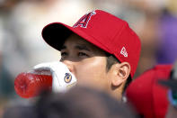American League's Shohei Ohtani, of the Los Angeles Angeles, drinks during batting practice for the MLB All-Star baseball game, Monday, July 12, 2021, in Denver. (AP Photo/Gabriel Christus)