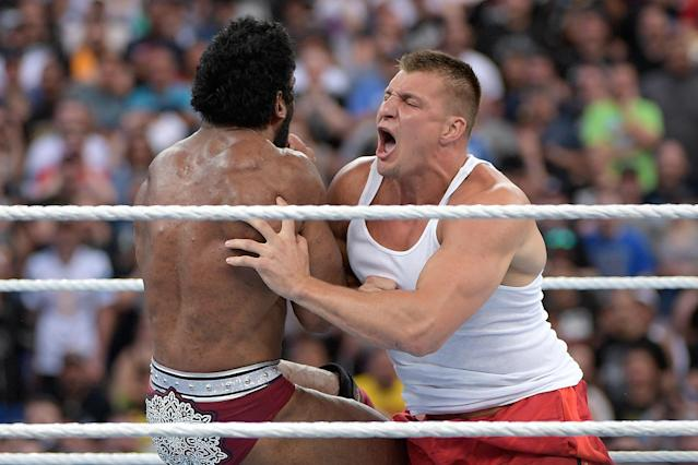 Rob Gronkowski delivers a body tackle to WWE Superstar Jinder Mahal during a match at WrestleMania 33 in 2017. (AP)