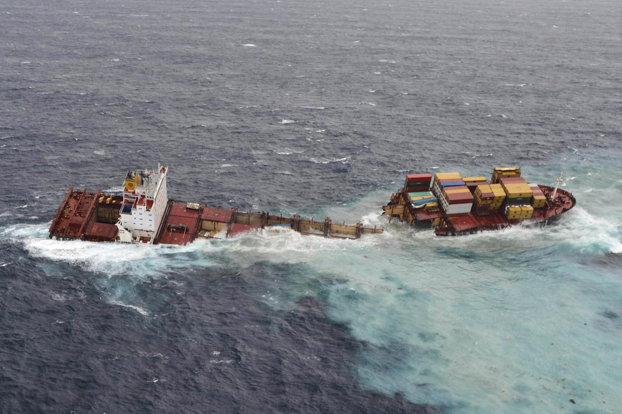 In this Sunday, Jan. 8, 2012, photo released by Maritime New Zealand, the cargo ship Rena, grounded off Tauranga Harbor, New Zealand, is seen split into two pieces after being lashed by pounding seas. The Greek-owned Rena ran aground on Astrolabe Reef 14 miles (22 kilometers) from Tauranga Harbor on North Island on Oct. 5, 2011, spewing heavy fuel oil into the seas, fouling pristine beaches and killing up to 20,000 sea birds in what has been described as New Zealand's worst maritime environmental disaster. (AP Photo/Maritime New Zealand) EDITORIAL USE ONLY