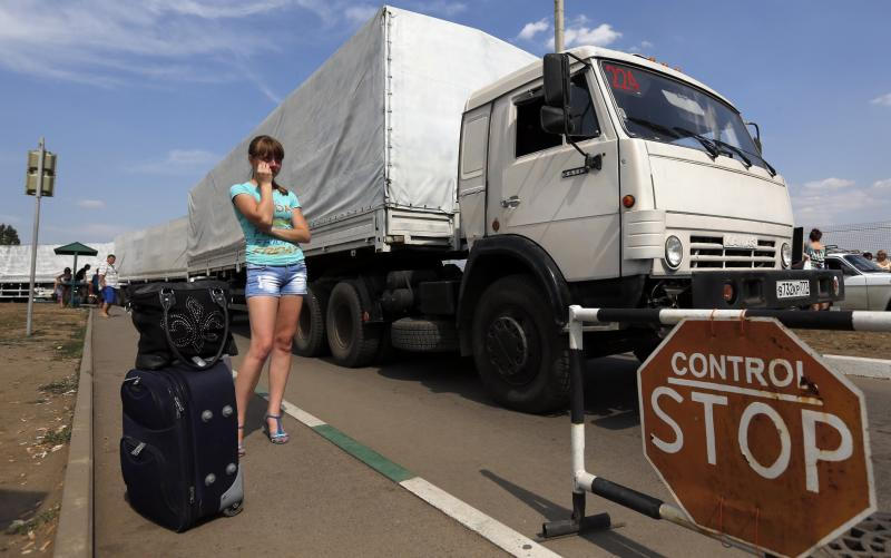"""Trucks of a Russian convoy carrying humanitarian aid for Ukraine drive onto the territory of a Russia-Ukraine border crossing point """"Donetsk"""" in Rostov Region"""