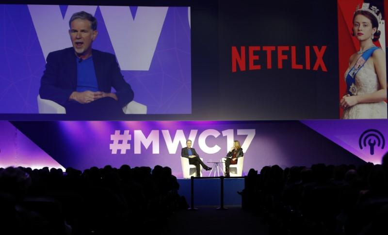 Netflix's CEO Hastings delivers his keynote speech during Mobile World Congress in Barcelona