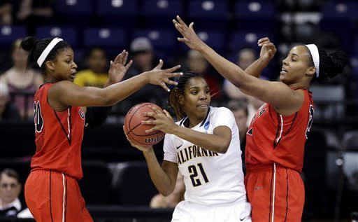 California's Reshanda Gray (21) is pressured by Georgia's Shacobia Barbee, left, and Jasmine Hassell during the first half in a regional final in the NCAA women's college basketball tournament, Monday, April 1, 2013, in Spokane, Wash. (AP Photo/Elaine Thompson)