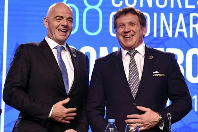 CONMEBOL president Alejandro Dominguez (R) and FIFA president Gianni Infantino in Buenos Aires, Argentina, on April 12, 2018