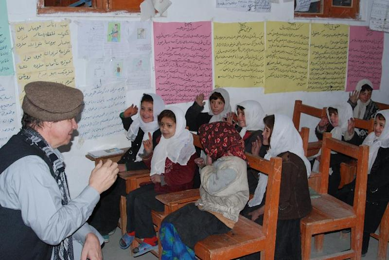 "In this November 2011 photo provided by the Central Asia Institute, the group's co-founder, Greg Mortenson, left, practices counting with first-graders in one of CAI's four schools in Zebak District, Badakhshan Province, Afghanistan. A federal judge on Monday, April 30, 2012 dismissed a lawsuit against author Mortenson, calling claims ""flimsy and speculative"" that the humanitarian and his publisher lied in his best-selling ""Three Cups of Tea"" and ""Stones Into Schools"" to boost book sales.  (AP Photo/Central Asia Institute, Sarfraz Khan)"