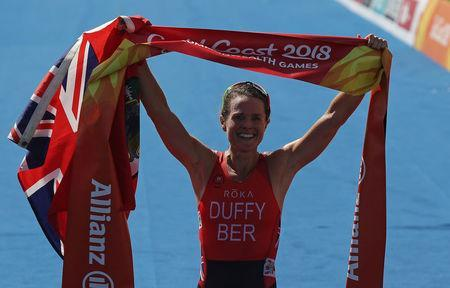 Triathlon - Gold Coast 2018 Commonwealth Games - Women's Final - Southport Broadwater Parklands - Gold Coast, Australia - April 5, 2018 - Flora Duffy of Bermuda celebrates after crossing the finish line in first place. REUTERS/Athit Perawongmetha