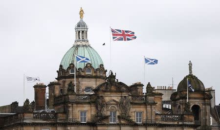 British and Scottish flags fly outside the Lloyds Banking Group's Scottish headquarters in Edinburgh, Scotland May 1, 2014. REUTERS/Suzanne Plunkett