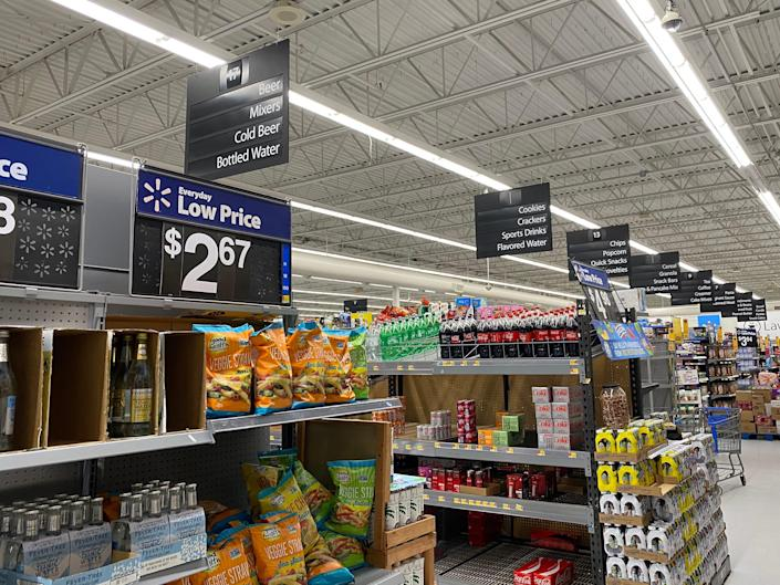 Eight grocery aisles at walmart filled with food and groceries