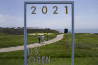 Fans walk along the third fairway during a practice round of the U.S. Open Golf Championship, Tuesday, June 15, 2021, at Torrey Pines Golf Course in San Diego. (AP Photo/Jae C. Hong)
