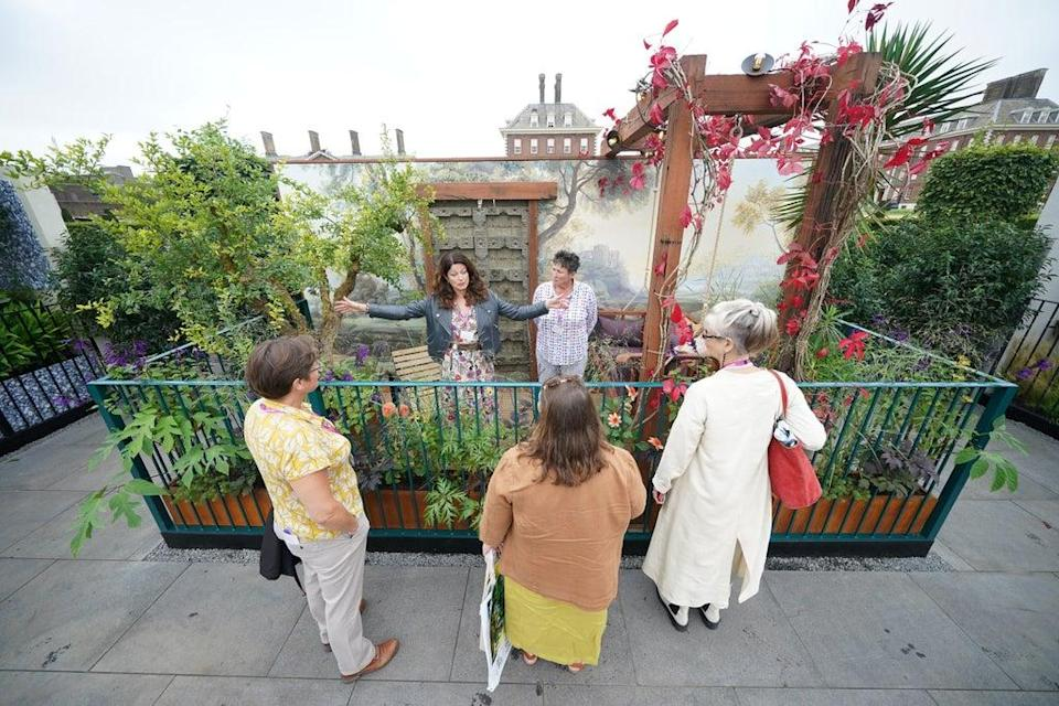 Designer Martha Krempel discusses her Arcadia balcony garden with visitors (Yui Mok/PA) (PA Wire)