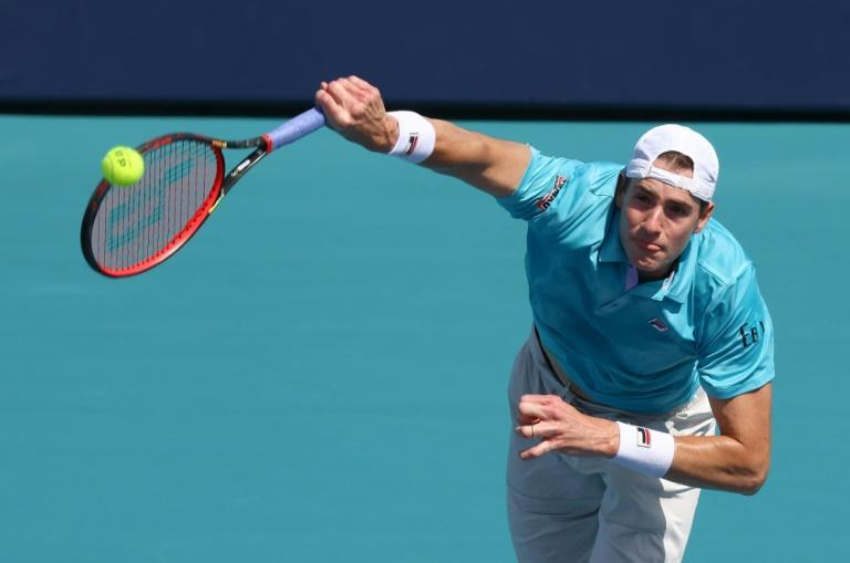 Former champion John Isner serves on the way to a third-round victory over Canadian Felix Auger-Aliassime at the Miami Open ATP and WTA hardcourt tournament