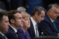 German Chancellor Angela Merkel, center, and French President Emmanuel Macron, second left, participate in a round table meeting at a NATO leaders meeting at The Grove hotel and resort in Watford, Hertfordshire, England, Wednesday, Dec. 4, 2019. As NATO leaders meet and show that the world's biggest security alliance is adapting to modern threats, NATO Secretary-General Jens Stoltenberg is refusing to concede that the future of the 29-member alliance is under a cloud. (AP Photo/Frank Augstein)