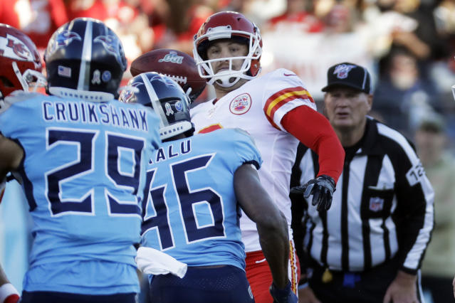 Kansas City Chiefs kick holder Dustin Colquitt passes the ball after a fumbled field goal snap in the second half of an NFL football game against the Tennessee Titans Sunday, Nov. 10, 2019, in Nashville, Tenn. Colquitt was penalized for intentional grounding and the Tennessee Titans took possession of the ball.(AP Photo/James Kenney)