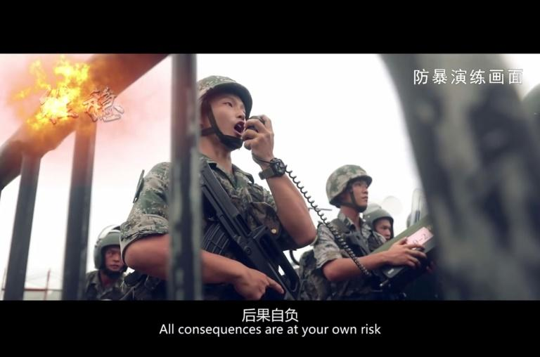 A screengrab from a Chinese military video showing a drill of troops quelling a protest in Hong Kong (AFP Photo/Handout)