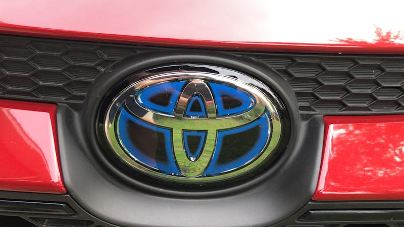 An electric-blue badge helps identify the Corolla as a hybrid.