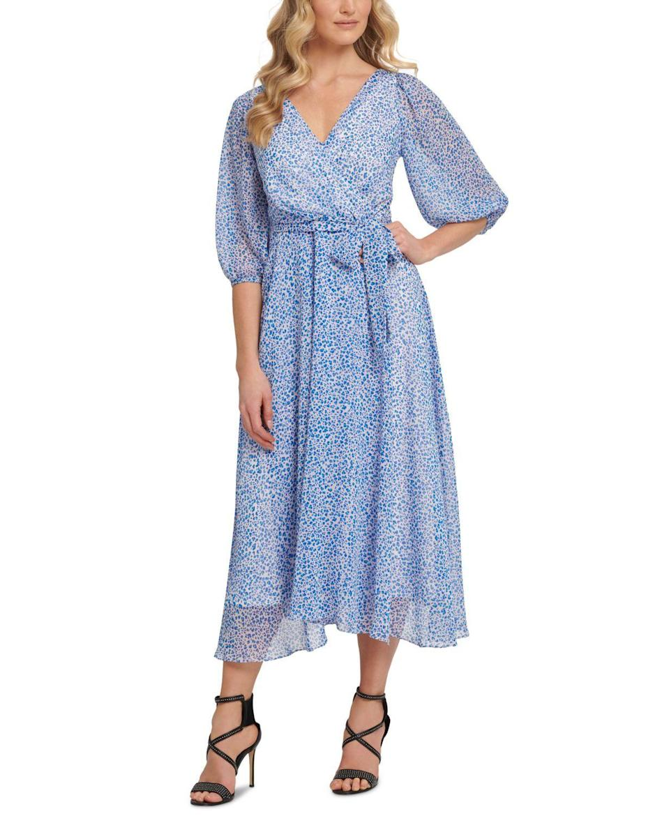 """<p><strong>DKNY</strong></p><p>macys.com</p><p><strong>$129.00</strong></p><p><a href=""""https://go.redirectingat.com?id=74968X1596630&url=https%3A%2F%2Fwww.macys.com%2Fshop%2Fproduct%2Fdkny-printed-balloon-sleeve-faux-wrap-dress%3FID%3D12231127&sref=https%3A%2F%2Fwww.womenshealthmag.com%2Flife%2Fg36173394%2Fsummer-wedding-guest-dresses%2F"""" rel=""""nofollow noopener"""" target=""""_blank"""" data-ylk=""""slk:Shop Now"""" class=""""link rapid-noclick-resp"""">Shop Now</a></p><p>A playful printed dress with an always flattering faux-wrap look offers the perfect mix of summer fun and fancy elegance. </p>"""