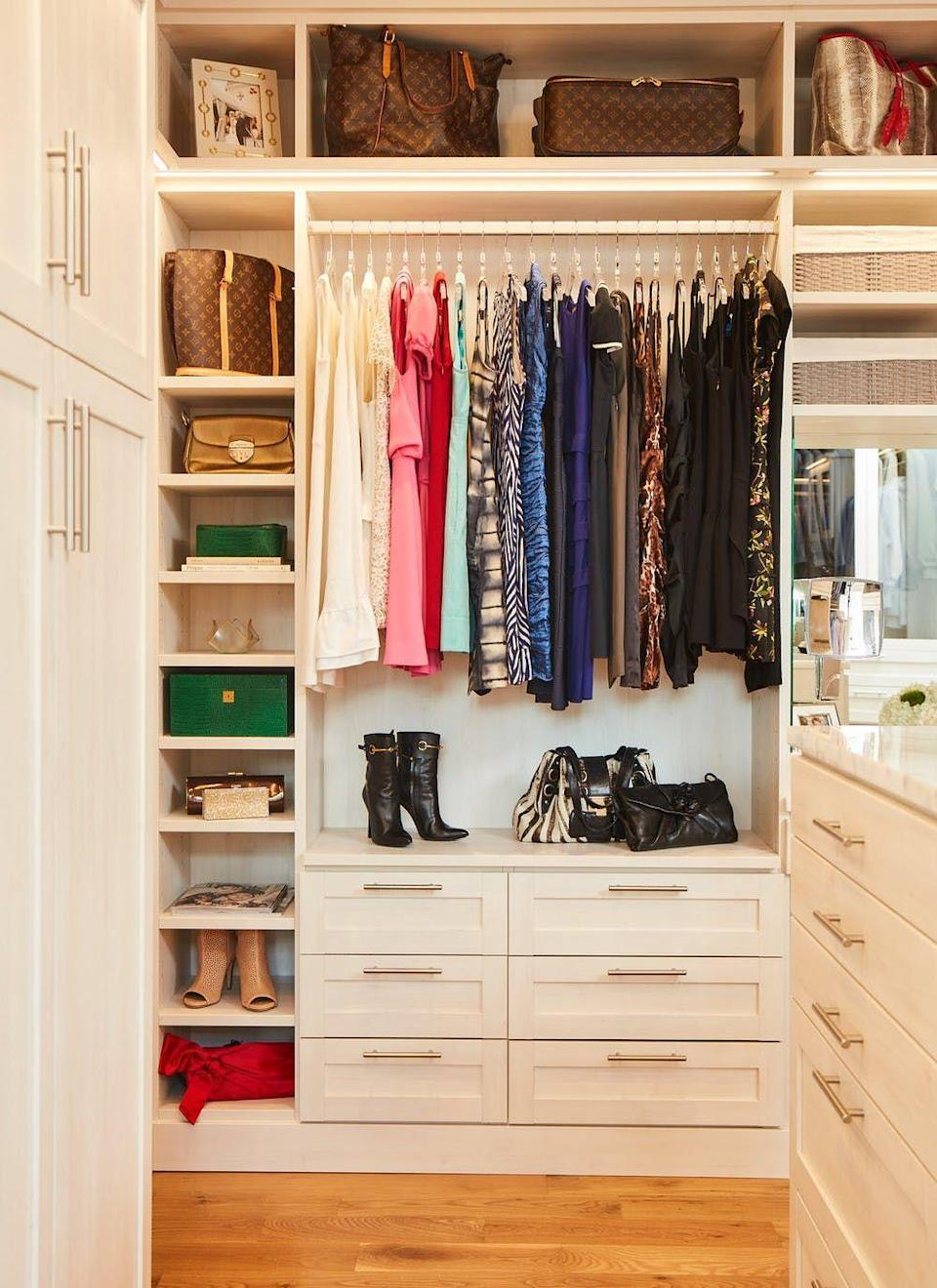 "<p>Double your closet's storage potential by raising the top clothing rod above standard height to free up usable space below. Install drawers or bring in a freestanding dresser to fake a built-in look. </p><p>See more at <a href=""https://go.redirectingat.com?id=74968X1596630&url=https%3A%2F%2Fwww.containerstore.com%2Fblog%2Fposts%2Fmaster-laren-closet-by-a-master-organizer&sref=https%3A%2F%2Fwww.oprahmag.com%2Flife%2Fg29994972%2Fbest-closet-organizer-ideas%2F"" rel=""nofollow noopener"" target=""_blank"" data-ylk=""slk:Container Stories"" class=""link rapid-noclick-resp"">Container Stories</a>. </p>"