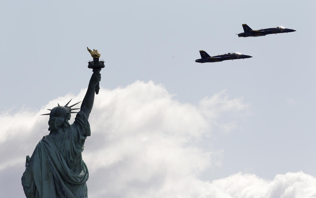 Two US Navy Flight Demonstration Squadron jets, better known as Blue Angels, seen from Liberty State Park in Jersey City, N.J., execute a survey flight over the Statue of Liberty, Monday, April 2, 2012. The two F/A-18 Hornet Fighter Jets, flew practice runs to familiarize and evaluate a potential flight course for the upcoming US Navy War of 1812 commemoration during this year's Fleet Week celebration in May. (AP Photo/Julio Cortez)